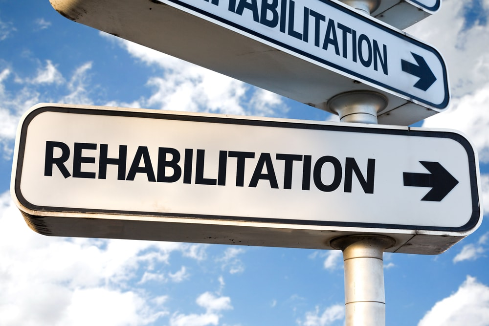 Street Sign with the word Rehabilition and an Arrow to Signify Xanax Rehablilitation