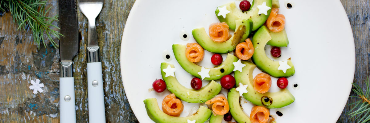 Gourmet Christmas appetizer - Christmas tree avocado salmon carpaccio, restaurant serving